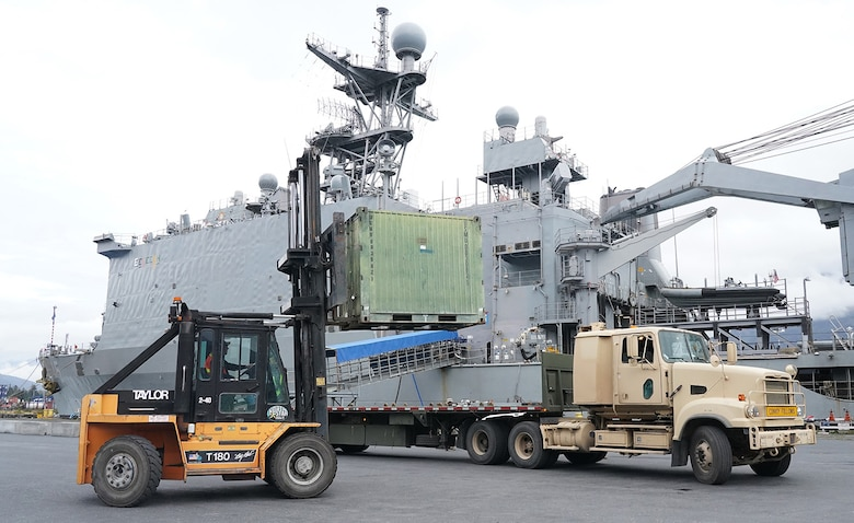 Soldiers assigned to the 109th Transportation Company, 17th Combat Support Sustainment Battalion, U.S. Army Alaska, load U.S. Marine Corps bulk fuel supplies and equipment from the U.S.S. Comstock (LSD-45), a Whidbey Island-class dock landing ship, on an M872 trailer at the port of Seward, Alaska, Sept. 19, 2019, for transport to Joint Base Elmendorf-Richardson, Alaska. The U.S. Navy is conducting an Arctic Expeditionary Capabilities Exercise to test its logistical effectiveness and joint-service interoperability while responding to conflict or disaster in an austere environment with no organic assets.