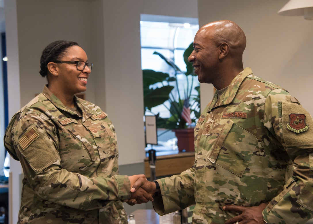 Chief Master Sergeant of the Air Force Kaleth O. Wright presents a coin to Senior Airman Kayla Terrell, 30th Comptroller Squadron financial operations technician, at Breakers Dining Facility, Sept. 25, 2019 at Vandenberg Air Force Base, Calif. Wright began his visit with a breakfast where he met with Airmen to learn their personal stories and their outlooks on the Air Force. (U.S. Air Force photo by Airman 1st Class Aubree Milks)