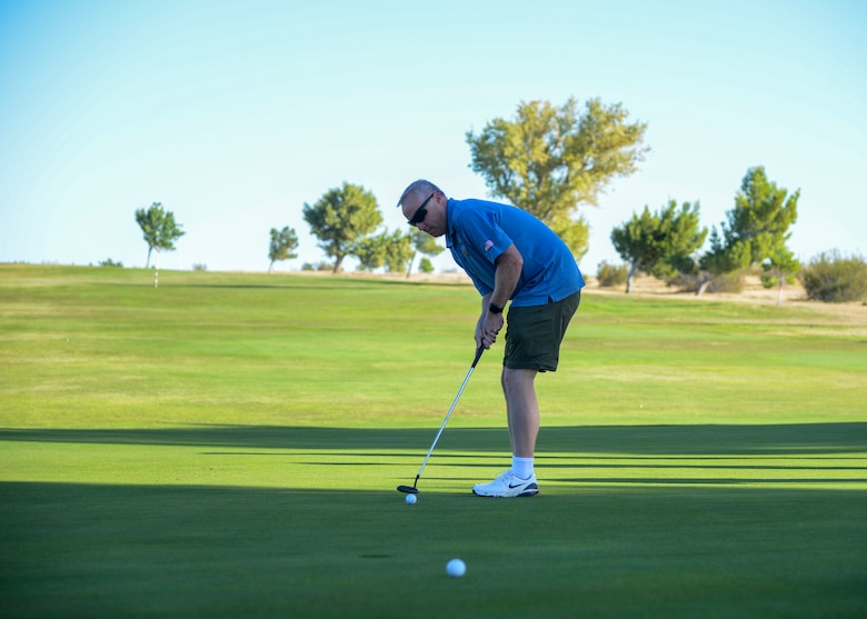Col. Kirk Reagan, 412th Test Wing Vice Commander, hits a putt during a golf tournament as part of the U.S. Air Force Test Pilot School 75th anniversary celebration at Edwards Air Force Base, California, Sept. 21. (U.S. Air Force photo by Giancarlo Casem)