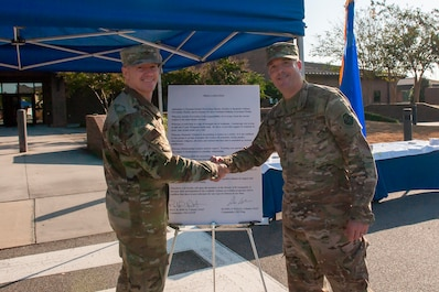 Col. Paul Birch, left, 93d Air Ground Operations Wing commander, shakes hands with Col. Daniel Walls, 23d Wing commander, during the Violence Prevention Awareness event Sept. 25, 2019, at Moody Air Force Base, Ga. The Violence Prevention Awareness event recognized and informed Airmen about suicide, domestic violence prevention and stalking awareness. (U.S. Air Force photo by Airman Elijah M. Dority)