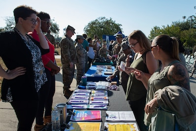 Attendees of the Violence Prevention Awareness event interact with booths supporting the cause Sept. 25, 2019, at Moody Air Force Base, Ga. The Violence Prevention Awareness event recognized and informed Airmen about suicide, domestic violence prevention and stalking awareness. (U.S. Air Force photo by Airman Azaria E. Foster)