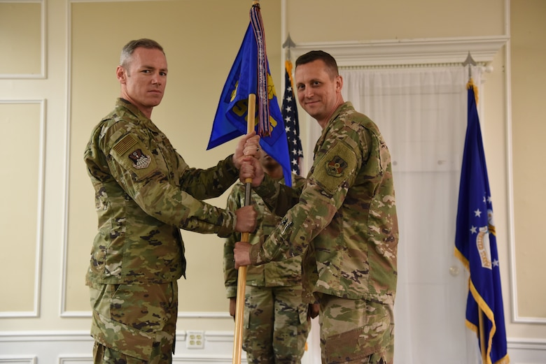 Col. Coleman passing the guidon to Lt. Col. Reid.