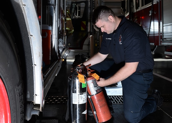 Corey Harrison, 55th Civil Engineer Squadron firefighter, inspects water and foam fire extinguishers Sept. 19, 2019, inside the main fire station at Offutt Air Force Base, Nebraska. The Offutt Fire Department is teaming up with the National Fire Protection Association for this year's Fire Prevention Week campaign held Oct. 6-12, 2019. (U.S. Air Force photo by Charles J. Haymond)