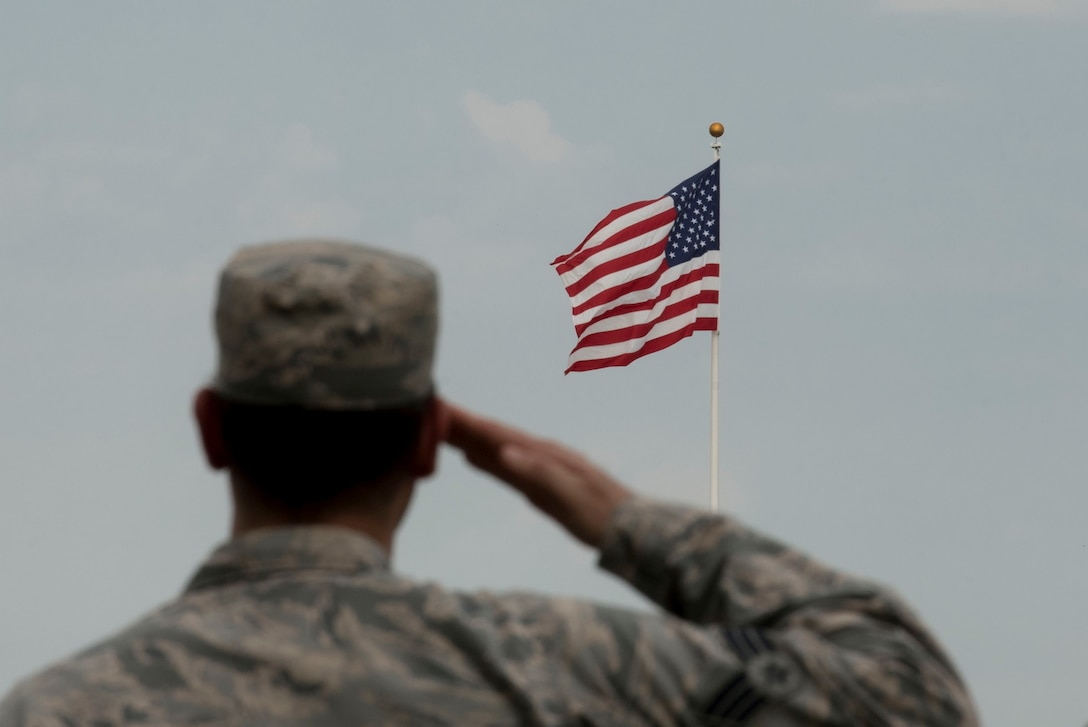 U.S. Air Force Senior Airman Daniel Caraglio, prisoner of war/missing in action (POW/MIA) project officer, salutes the American flag during a retreat ceremony, at Shaw Air Force Base, South Carolina, Sept. 17, 2019.