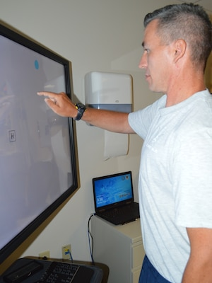 Air Force 1st Lt. Jason Hibbetts practices his cognitive function by touching a moving dot on a video screen Aug. 13 at the Brain Injury Rehabilitation Service at Brooke Army Medical Center at Joint Base San Antonio-Fort Sam Houston. The BIRS provides comprehensive outpatient neurorehabilitation for service members, family members and military retirees recovering from a stroke or other brain injuries using an interdisciplinary approach including physical therapy, occupational therapy, speech language pathology, recreational therapy, psychology, neuropsychology and case management.