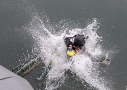 A Peruvian navy diver enters the water.