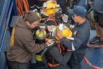 Peruvian navy divers don equipment prior.