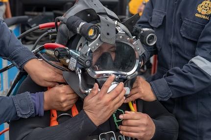 Peruvian navy divers check diving equipment.