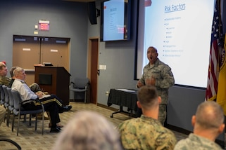 Air Force Master Sgt. Seneca Linder gives suicide prevention training to Joint Task Force Civil Support members at the command's headquarters. During the brief, members learned about some of the risk factors and signs of potential suicide, and how to help someone facing suicide. (Official DoD photo by Mass Communication Specialist 3rd Class Michael Redd/RELEASED)