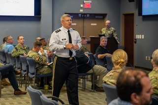"Joint Task Force Civil Support (JTF-CS) Commanding General U.S. Army Maj. Gen. William ""Bill"" Hall speaks to JTF-CS members during an all hands call at the command's headquarters. Also during the all hands call the command received suicide prevention training. (Official DoD photo by Mass Communication Specialist 3rd Class Michael Redd/RELEASED)"