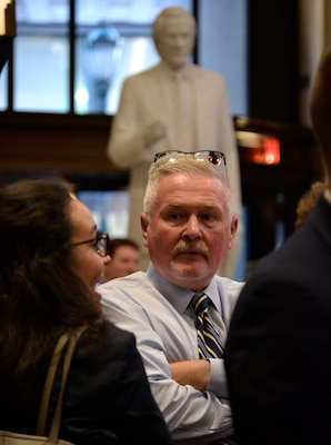 Jon Lightner, center, DLA Troop Support chief counsel and panel speaker at a local law school education event, listens to questions from local law students at an education and networking event Sept. 19, 2019 in Philadelphia.