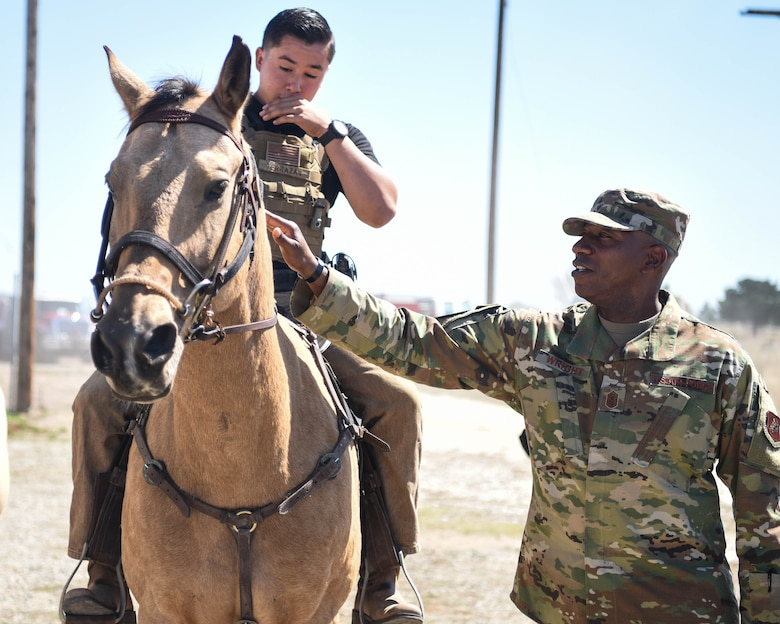 Chief Master Sergeant of the Air Force Kaleth O. Wright greets Senior Airman Michael Terrazas, 30th Security Forces conservation patrolman, and Military Working Horse Duke Sept. 25, 2019, at Vandenberg Air Force Base, Calif. The 30th SFS MWH law enforcement unit is the only equine patrol unit within the Department of Defense and is one of four conservation units in the U.S. Air Force. (U.S. Air Force photo by Airmen 1st Class Hanah Abercrombie)