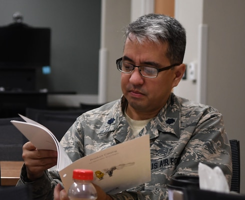 A student from the Air Force Post Graduate Dental School surgical skills and readiness course reviews the material during a lecture at the AFPDS, Joint Base San Antonio-Lackland Sept. 18. The training is a combination of three courses being run simultaneously to maximize use of resources and time.