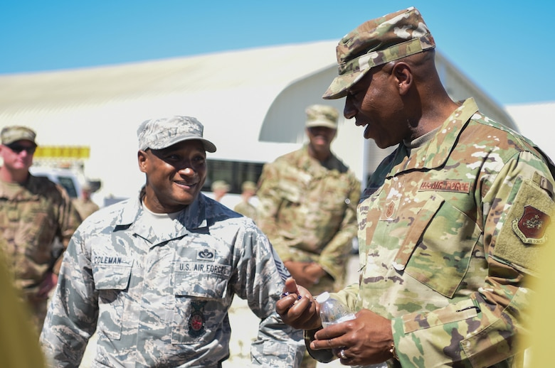 Chief Master Sergeant of the Air Force Kaleth O. Wright talks with Senior Master Sgt. Corey Coleman, 30th Civil Engineer Squadron deputy fire chief, while visiting the 30th Civil Engineer Squadron high voltage pole training yard for a demonstration Sept. 25, 2019, at Vandenberg Air Force Base, Calif. Wright was able to meet with members assigned to the Air Force's only Hot Shot team and learn about their crucial role at Vandenberg AFB. (U.S. Air Force photo by Airmen 1st Class Hanah Abercrombie)