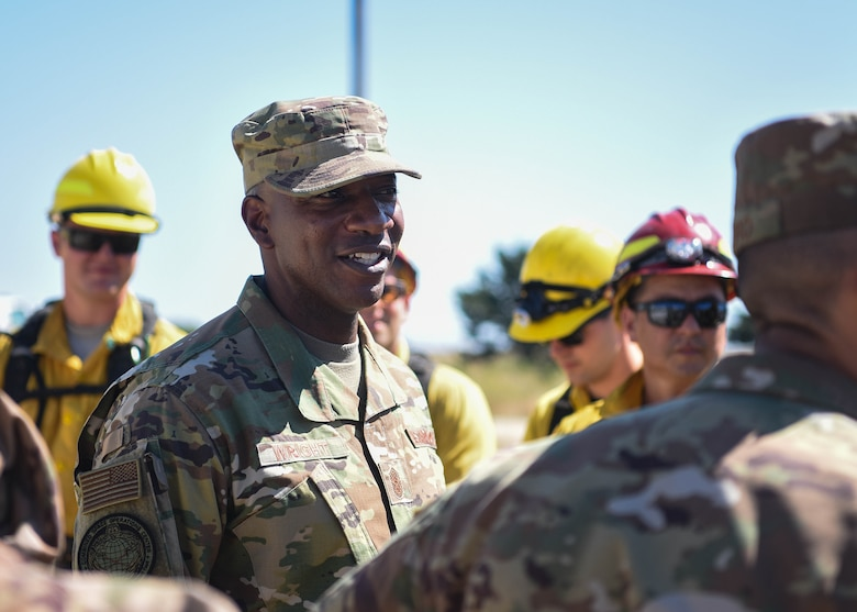 Chief Master Sergeant of the Air Force Kaleth O. Wright visits the 30th Civil Engineer Squadron high voltage pole training yard for a demonstration Sept. 25, 2019, at Vandenberg Air Force Base, Calif. Wright was able to meet with members assigned to the Air Force's only Hot Shot team and Military Working Horse law enforcement unit, as well as witness them in action. (U.S. Air Force photo by Airmen 1st Class Hanah Abercrombie)