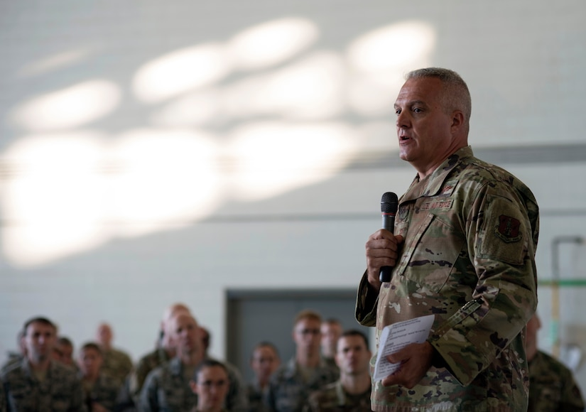 """Air Force Col. David Johnson, commander of the 121st Air Refueling Wing, speaks to Airmen about suicide prevention during a """"resilience tactical pause'"""" day at Rickenbacker Air National Guard Base in Columbus, Ohio, Sept. 14, 2019. The National Guard has launched or participated in suicide prevention initiatives throughout 2019. A Department of Defense report released Sept. 26, 2019, underscores the significant challenges the Guard faces in suicide prevention."""