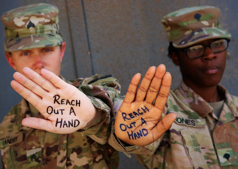 Army Sgt. Rebecca Landry and Spc. Asia Jones highlight the importance of suicide prevention and awareness at Camp Taji, Iraq, June 5, 2019. The National Guard has launched or participated in suicide prevention initiatives throughout 2019. A Department of Defense report released Sept. 26, 2019, underscores the significant challenges the Guard faces in suicide prevention.