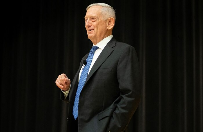 Retired Gen. and former Secretary of Defense, James Mattis, chuckles during a story he told at Little Hall on Marine Corps Base Quantico, Sept. 25, 2019. Mattis talks about how to improve leadership skills to the audience by making his message personal through bringing up stories about his Marine Corps career. (U.S. Marine Corps photo by Lance Cpl. Piper A. Ballantine)
