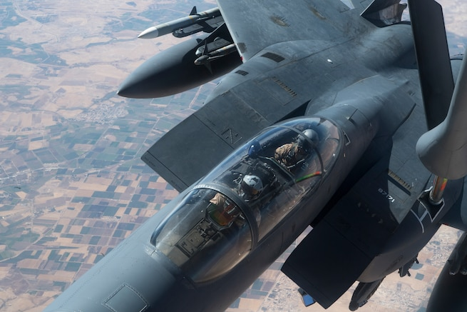 A U.S. F-15E Strike Eagle receives fuel from a 28th Expeditionary Air Refueling Squadron KC-135 Stratotanker during a combat air patrol mission over an undisclosed location in Southwest Asia, Sept. 24, 2019. The Strike Eagle plays a key role in Air Force Central Command operations by maintaining constant readiness in support of air operations, providing deterrence and stability, and bolstering the mission efforts of coalition partners. (U.S. Air Force photo by Master Sgt. Russ Scalf)