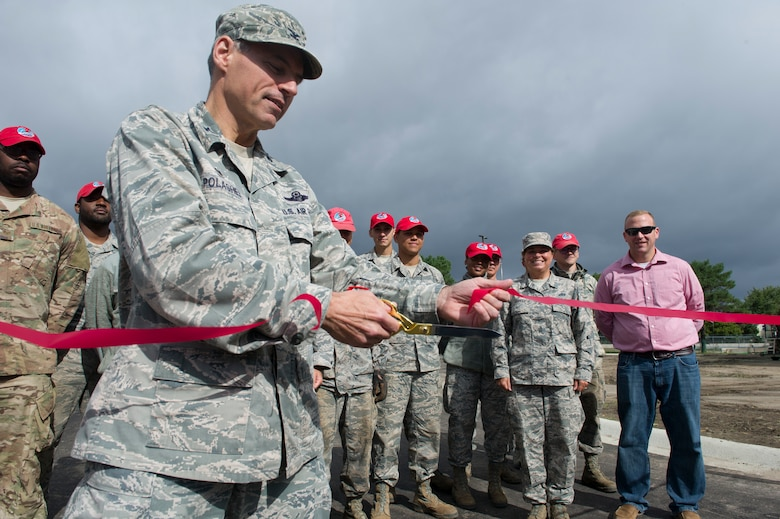 Col. Anthony Polashek, 934th Airlift Wing commander, cut the ceremonial ribbon for the opening of a new perimeter road at the Minneapolis-St. Paul Air Reserve Station, September 13, 2019.  (U.S. Air Force photo by Chris Farley)