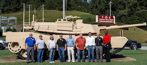 Group standing in front of Abrams tank.