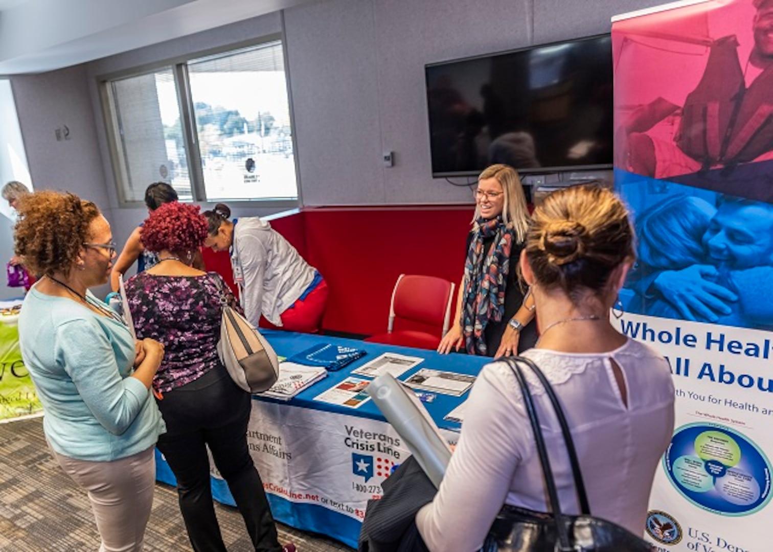 Associates discuss health topics with VA Medical Center vendors during Resiliency Fair, September 25.