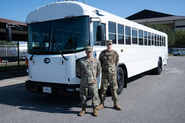 U.S. Air Force Staff Sgt. Christopher Carpe, 81st Logistics Readiness Squadron ground transportation and equipment support NCO in charge, and Airman 1st Class Jared Hill, ground transportation personnel, pose for a photo on Keesler Air Force Base, Sept. 26, 2019. Carpe and Hill assisted in transporting elderly residents of the Seashore Oaks Assisted Living Facility away from the area after a fire evacuation. (U.S. Air Force photo by Airman 1st Class Kimberly L. Mueller)