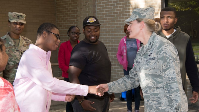 Col. Jocelyn J. Schermerhorn, 11th Wing vice commander, shakes hands with a Project Search intern at Joint Base Andrews, Aug. 29, 2019. Project Search, which began in 1996 at the Cincinnati Children's Hospital, establishes internships at local businesses and government organizations for students with disabilities. (U.S. Air Force photo by Airman 1st Class Spencer J. Slocum)