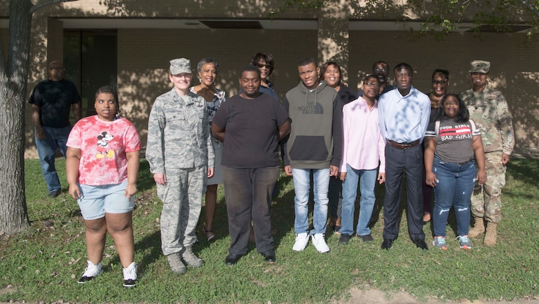 Project Search interns pose for a photo with base officials at Joint Base Andrews, Md., Aug. 29, 2019. The students will work on base on a 10-month long work cycle, rotating through three different job sites, in an effort to develop the employment skills needed for self-determination, management and self-advocacy. (U.S. Air Force photo by Airman 1st Class Spencer J. Slocum)