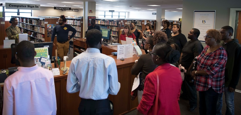 Project Search tour members visit the library at Joint Base Andrews, Md., Aug. 29, 2019. The library is one of many possible work stations interns will have the opportunity to work during their 10-month program on the installation. (U.S. Air Force photo by Airman 1st Class Spencer J. Slocum)