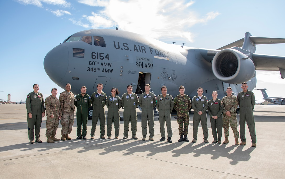 U. S. Air Force and coalition service members stand in front of a C-17 Globe Master III during exercise Mobility Guardian Sept. 25, 2019, at Travis Air Force Base, California. MG19 is Air Mobility Command's full spectrum readiness exercise, designed to strengthen and improve integrated teamwork. U.S. aircraft joined aircraft from more than two dozen nations along with more than 4,000 U.S. and international Air Force, Army, Navy, and Marine Corps service members. (U.S. Air Force photo by Heide Couch)
