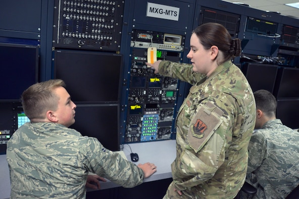 Airmen train on a replica of an aircraft computer system.