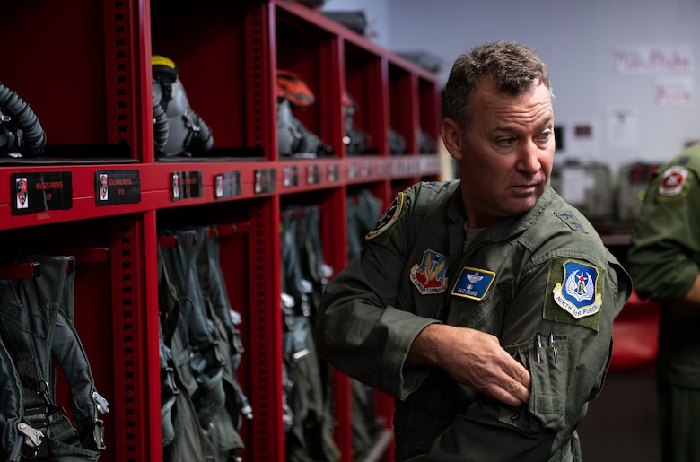 U.S. Air Force Maj. Gen. Chad Franks, Ninth Air Force commander, suits up before flying in an F-15E Strike Eagle at Seymour Johnson Air Force Base, N.C., Sept. 24, 2019. This is the general's first visit to the 4th Fighter Wing since assuming command of the Ninth AF. (U.S. Air Force photo by Senior Airman Kenneth Boyton)