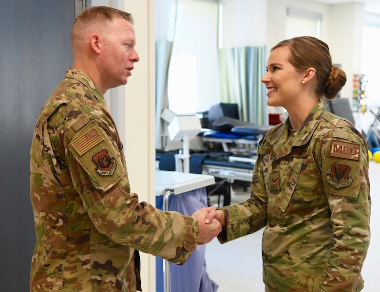 U.S. Air Force Chief Master Sgt. Benjamin W. Hedden, left, Ninth Air Force command chief, greets Senior Airman Mariah Griffin, 4th Medical Operations Squadron physical therapy specialist at the base clinic on Seymour Johnson Air Force Base, N.C., Sept. 24, 2019. During his trip, Hedden met with Airmen and listened to issues affecting Team Seymour. (U.S. Air Force photo by Staff Sgt. Michael Charles)
