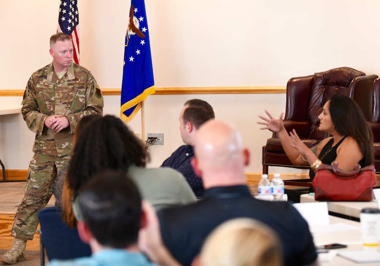 U.S. Air Force Chief Master Sgt. Benjamin W. Hedden, left, Ninth Air Force command chief, talks with attendees of the 4th Fighter Wing Frontline Leadership Course at the Red Horse Auditorium on Seymour Johnson Air Force Base, N.C., Sept. 23, 2019. During his trip, Hedden met with Airmen from the 4th FW to discuss the future of the Air Force and answer questions on a variety of topics. (U.S. Air Force photo by Staff Sgt. Michael Charles)