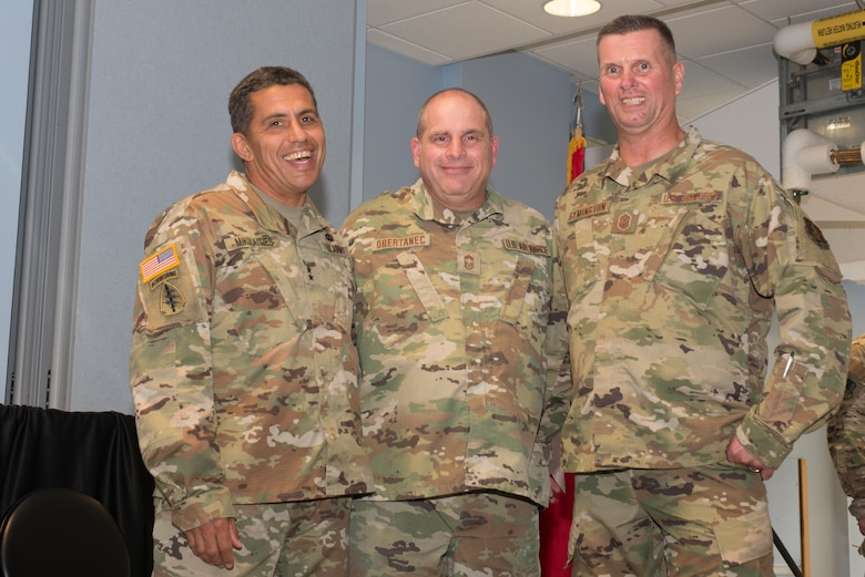 Maj. Gen. David Mikolaities, adjutant general, New Hampshire National Guard, Chief Master Sgt. David Obertanec, former state command chief, and Chief Master Sgt. John Symington, state command chief pose for picture before the change of command ceremony at Pease Air National Guard Base, Sept. 15, 2019. Symington assumed the state command chief position during the ceremony. (U.S. Air National Guard photo by Senior Airman Victoria Nelson)