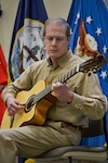 Raymond Smith, DLA Troop Support Clothing and Textile contract specialist, performs two short guitar selections written by Fernando Sor, a Spanish classical guitarist and composer, during the annual Hispanic Heritage Month celebration Sept. 25, 2019 in Philadelphia.  Troop Support and Naval Supply Systems Command Weapon Systems Support employees celebrated the culture and traditions of Hispanic Americans during a National Hispanic Heritage Month program.