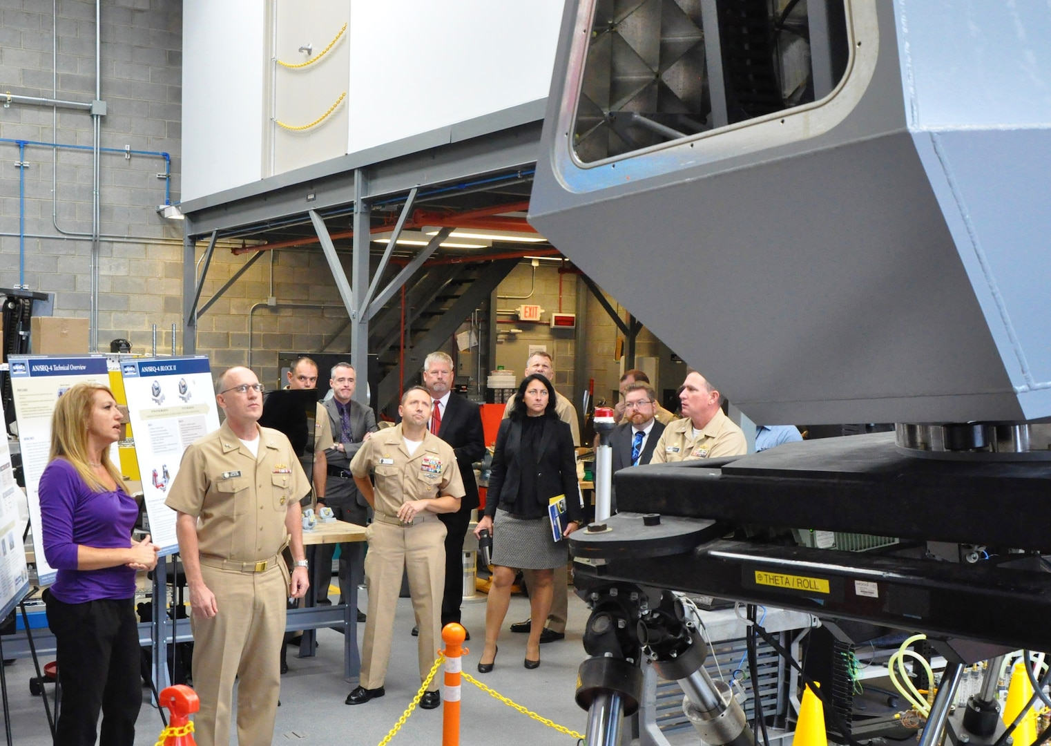 IMAGE: DAHLGREN, Va. (Sept. 6,  2019) - Theresa Gennaro, Naval Surface Warfare Center Dahlgren Division (NSWCDD) senior lead scientist for directed energy programs, briefs Rear Adm. Eugene 'Gene' Black, Surface Warfare Division director at the Office of the Chief of Naval Operations - on the Navy's high energy laser technological programs - including ODIN. The admiral was also updated on HELIOS -- High Energy Laser with Integrated Optical-Dazzler and Surveillance - during his NSWCDD tour. Gennaro was among the command's technical leaders and subject matter experts who briefed the admiral on a wide range of technologies encompassing modeling and simulation; guns and guided projectiles; Combined Integrated Air and Missile Defense Anti-Submarine Warfare; and virtualization. (U.S. Navy photo/Released)