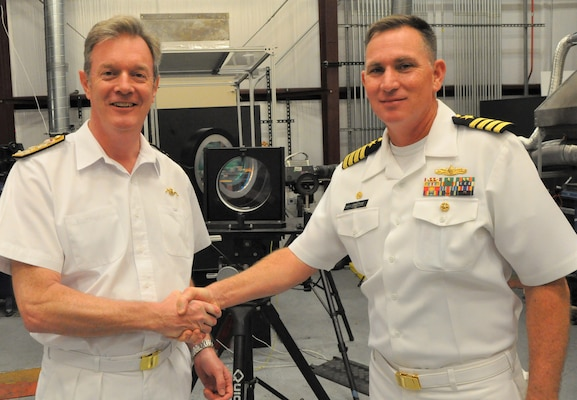 IMAGE: DAHLGREN, Va. (Sept. 25, 2019) - British Royal Navy Second Sea Lord Vice Adm. Nicholas Hine shakes hands with Capt. Casey Plew, Naval Surface Warfare Center Dahlgren Division (NSWCDD) commanding officer, during a presentation held after a live test demonstration. Plew and Hine presented each other with their respective command coins. NSWCDD subject matter experts briefed the second sea lord and his delegation on programs and capabilities that included the NSWCDD Innovation Lab, digitalization of the U.S. Navy, high velocity tactical development, and directed energy weapons such as the high energy laser, electromagnetic railgun and hyper-velocity projectile.  (U.S. Navy photo/Released)