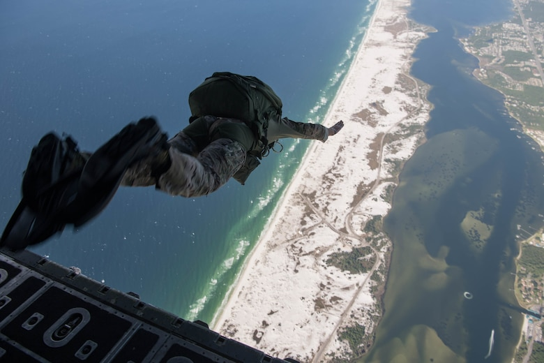 Col. exits an MC-130H Combat Talon II during his final military free-fall jump