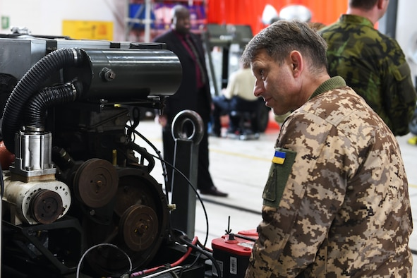 A foreign military delegate views an engine at the 48th Component Maintenance Squadron during a base visit as part of the Vienna Document 2011 agreement at RAF Lakenheath, United Kingdom, Sept. 24, 2019. The focus of the visit was to enhance understanding of U.S. combat air wing capabilities through a variety of information exchanges and observing activities on a combat air base. (U.S. Air Force photo by Senior Airman Christopher S. Sparks)