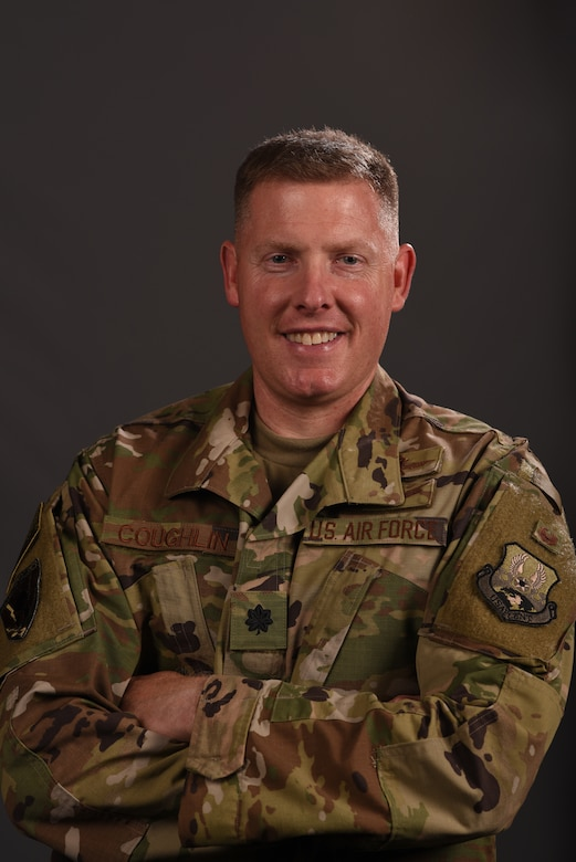 Lt. Col. Coughlin, United Sates Air Forces Central Command director of communications, smiles while in uniform, at Shaw Air Force Base, South Carolina, Aug. 20, 2019.