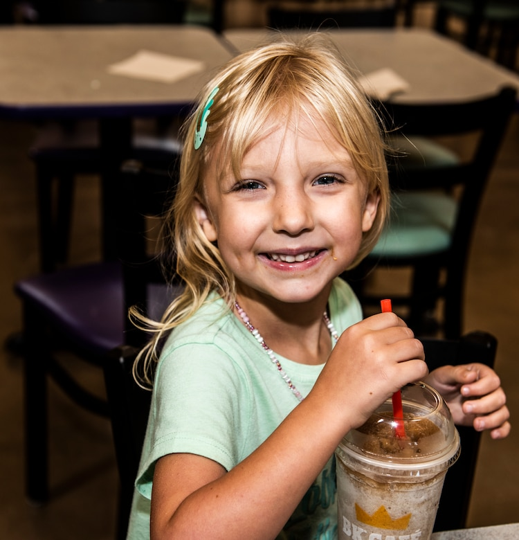 Lily, daughter of Lt. Col. Jim Coughlin, drinks a milkshake after mass at Shaw Air Force Base, S.C. Sept. 09, 2019.