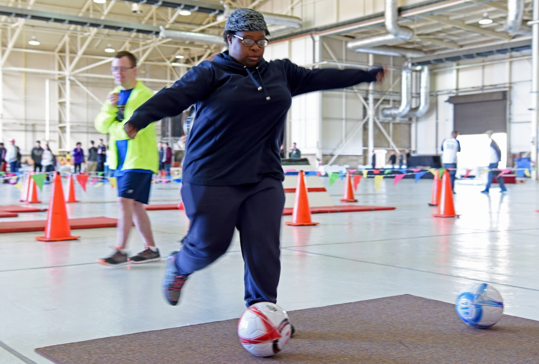 An athlete kicks a soccer ball during the 38th Annual Joan Mann Special Sports Day at RAF Mildenhall, England, Sept. 27, 2019. Joan Mann was a Ministry of Defence employee who worked in the RAF Mildenhall Public Affairs office many years ago. She organized the special sports day as a way to offer community members with special-needs a day of fun, and to bring the military and local community closer together. (U.S. Air Force photo by Staff Sgt. Matthew J. Wisher)