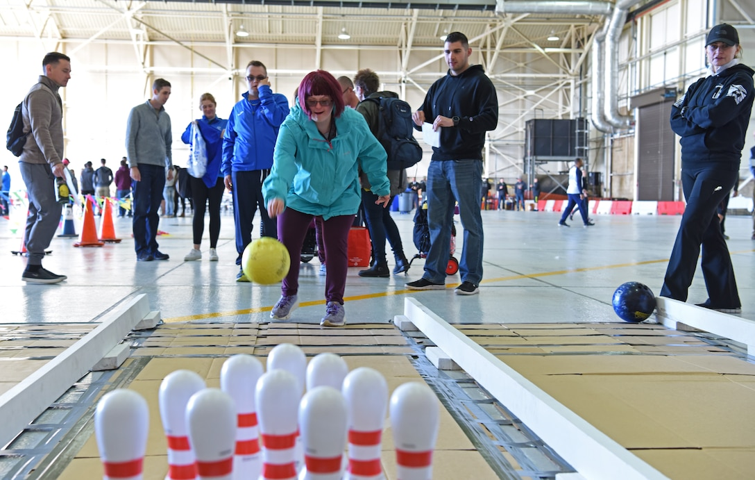 An athlete rolls a bowling ball during the 38th Annual Joan Mann Special Sports Day at RAF Mildenhall, England, Sept. 27, 2019. Approximately 600 volunteers from RAF Mildenhall, RAF Lakenheath, Airman Leadership School at RAF Feltwell, and RAF Honington assisted the special athletes. (U.S. Air Force photo by Staff Sgt. Matthew J. Wisher)
