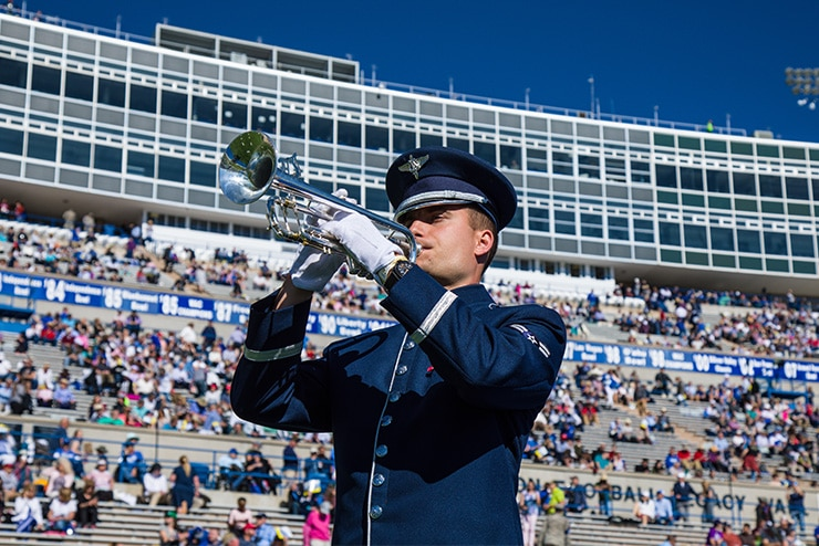 A1C Alexandru Szasz prepares to perform for the United States Air Force Academy's 2019 Graduation Ceremony on May 30th, 2019.  A1C Szasz and the Academy Band honored the nearly 1,000 graduates and welcomed the President of the United States in a ceremony viewed by nearly 33.5 million viewers worldwide.