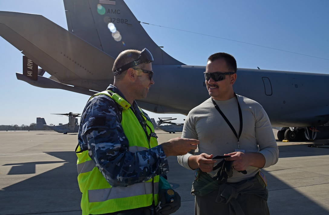 U.S. Air Force Staff Sgt. Austin Garcia, 92nd Aircraft Maintenance Squadron flying crew chief, and Royal Australian Air Force Sgt. Kane O'Connor, 23rd Squadron aircraft refueler, trade unit patches during the first Airborne Warning and Control System World Tour at RAAF Amberley, Australia, Sept. 15, 2019.  During the world tour, Fairchild Air Force Base and Tinker AFB aircrew displayed global reach by successfully completing mission goals at multiple locations to include Alaska, Hawaii and Australia. (U.S. Air Force photo by Senior Airman Jesenia Landaverde)