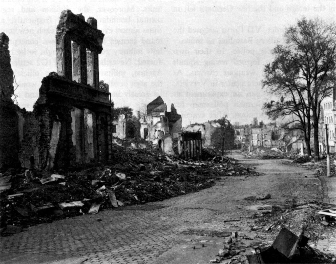 A street view of buildings in ruins.