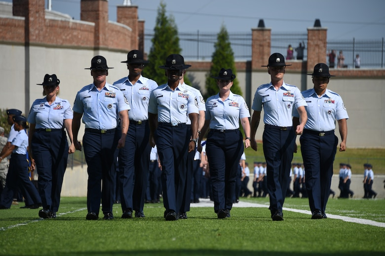 "Military training instructors from Officer Training School ""Godzilla"" class 19-07 march forward during a graduation ceremony Sept. 27, 2019, Montgomery, Alabama. Class 19-07, also known as ""Godzilla Class,"" spent the last eight weeks taking part in a series of field training and classroom leadership exercises preparing them to become Air Force officers."