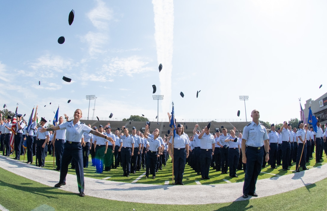 "The Air Force's newest commissioned officers a part of Officer Training School class 19-07 throw their flight caps in the air following their graduation ceremony Sept. 27, 2019, in Montgomery, Alabama. Officer Training School's class 19-07, or also known as ""Godzilla Class"" is the school's largest class in history and pushed OTS to its maximum capacity"
